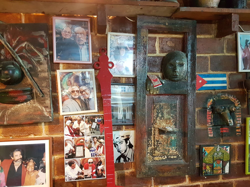 Inside the restaurant/bar on the compound. Many popular celebrities have visited and taken pictures with Salvador, and it's showcased on the wall.