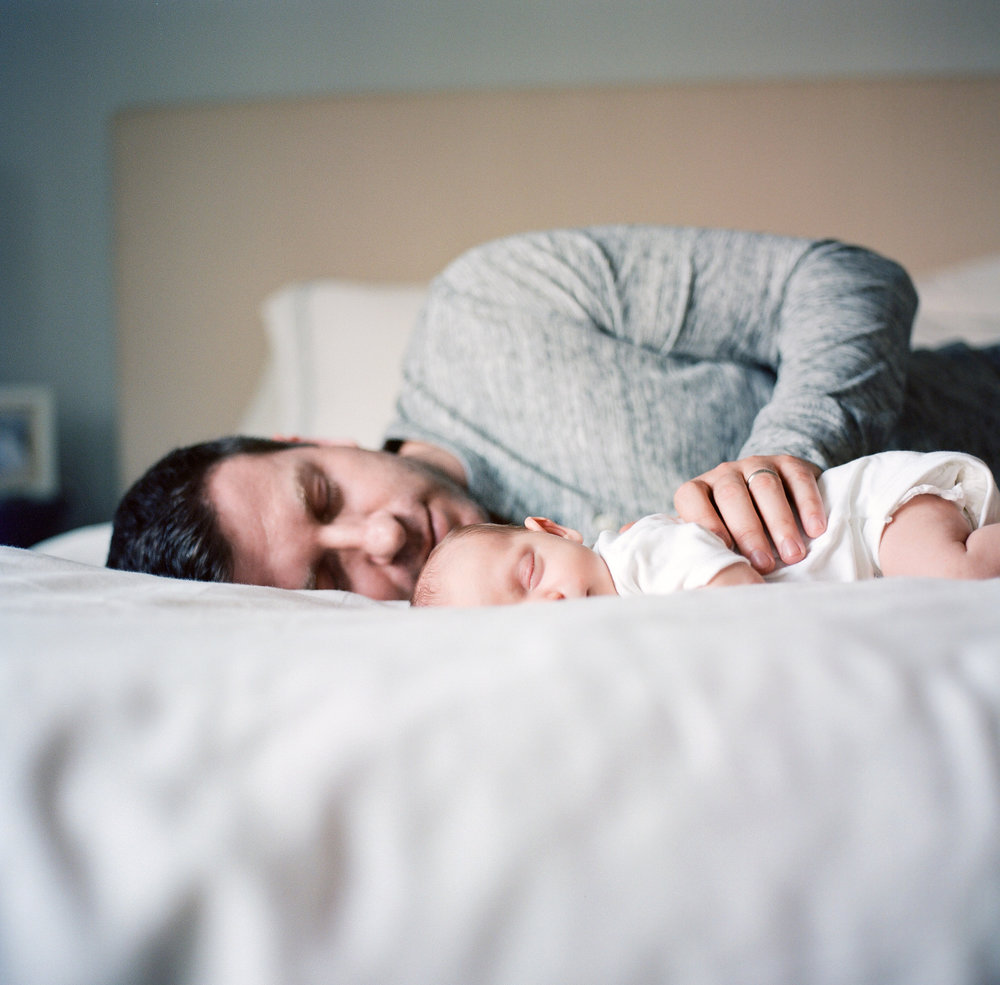 dad and newborn sleeping