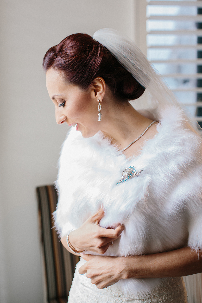 the bride's fur wrap and vintage broach