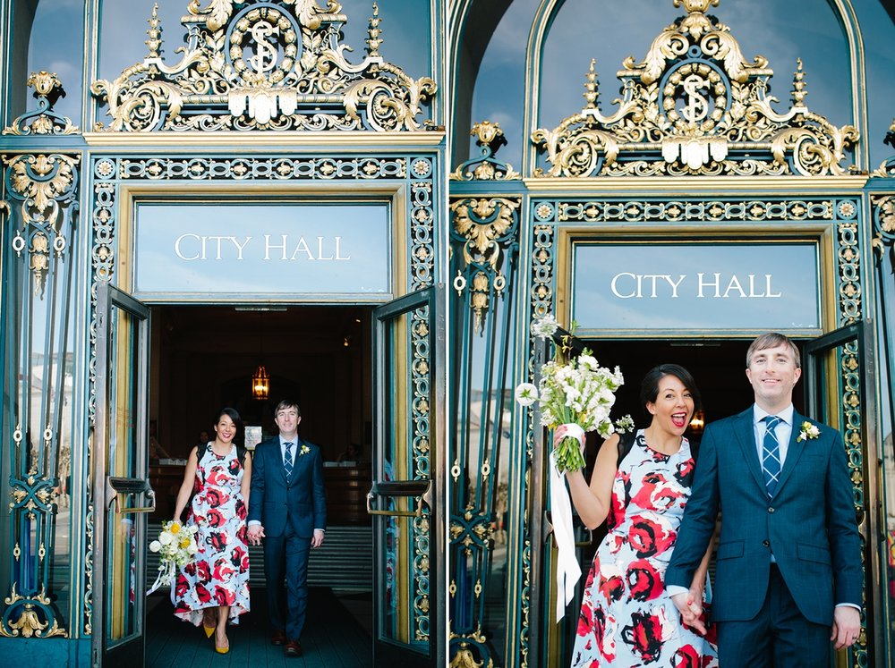 The bride and groom exiting through the doors of San Francisco City Hall.