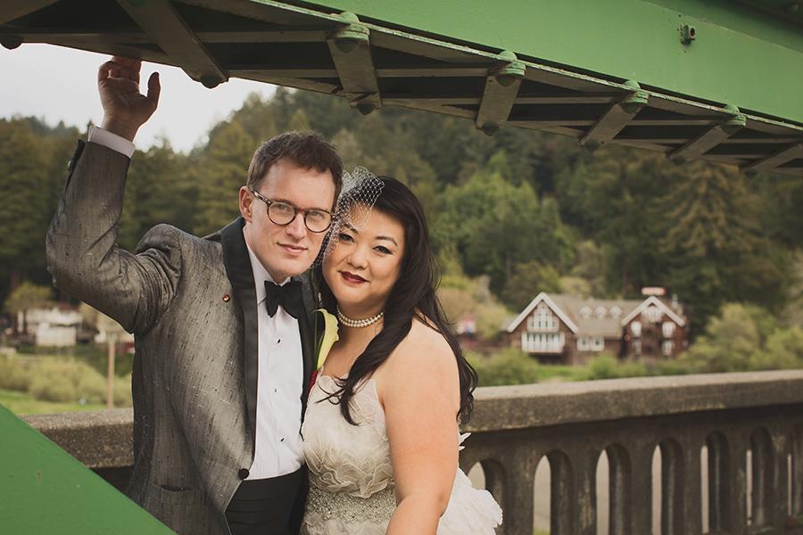 Bride and groom on bridge in Monte Rio, over the Russian River.
