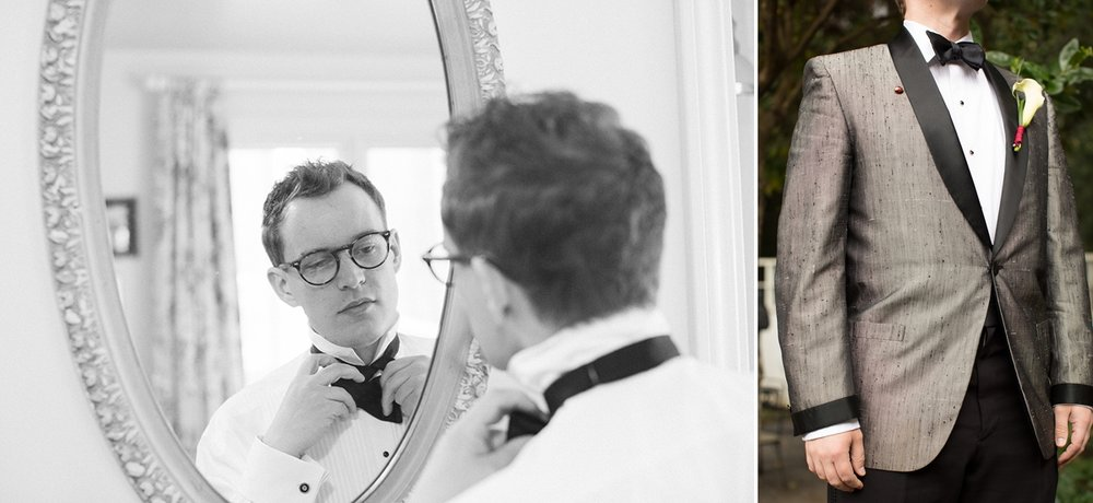 Groom tying bow tie in mirror and wearing vintage sharkskin tuxedo at the Highland Dell Lodge in Monte Rio.