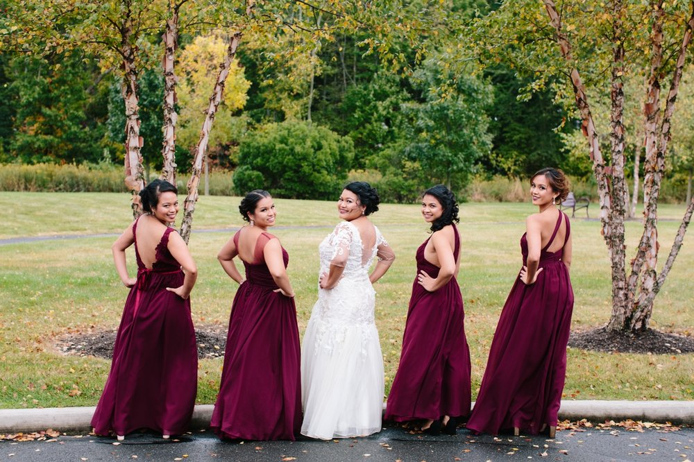 The bride with her bridesmaids in fall colors.