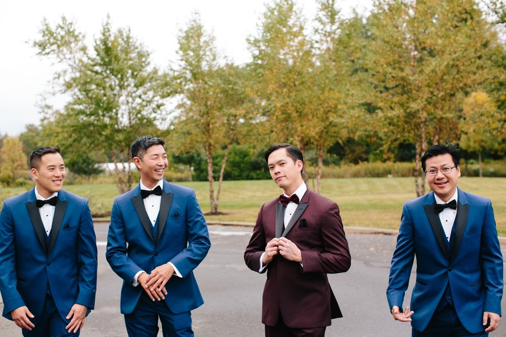 Jonathan looked quite dapper in his burgundy tuxedo, and his groomsmen in navy blue.