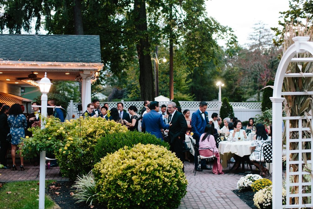Wedding cocktail hour on the patio in October at Washington Crossing Inn.