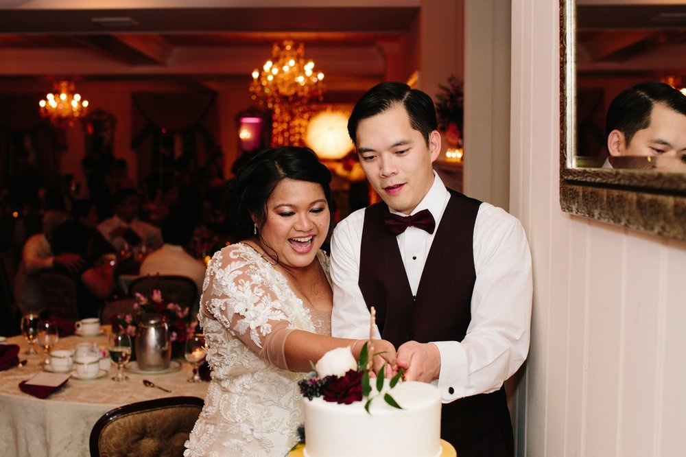 Bride and groom cut the cake at their wedding at the Washington Crossing Inn.