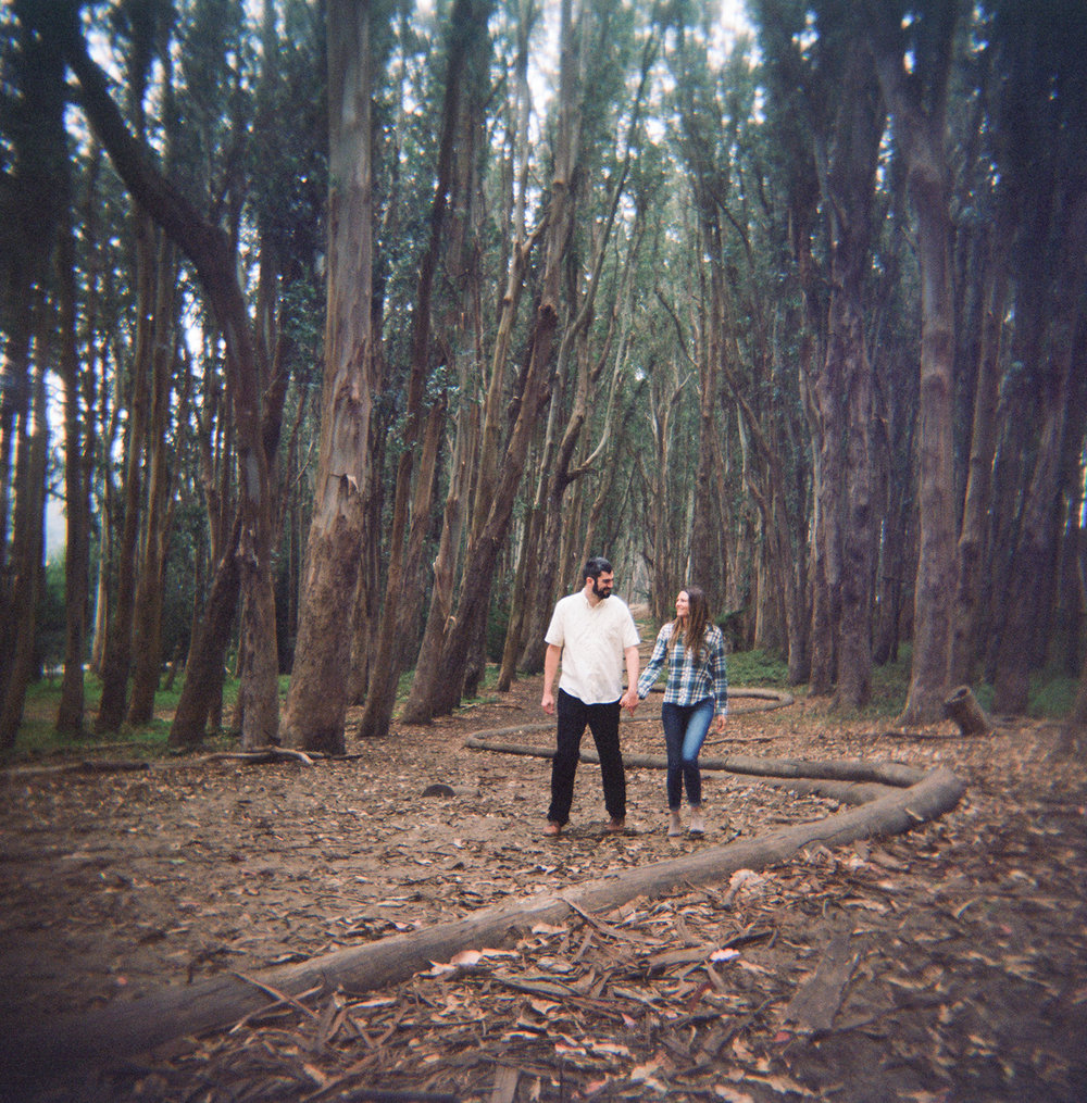 Engaged couple walking the Wood Line in the Presidio of San Francisco.