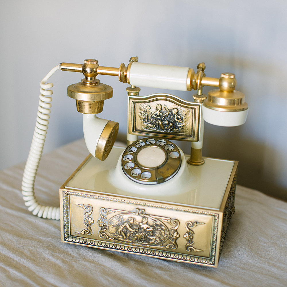 Vintage gold and white telephone