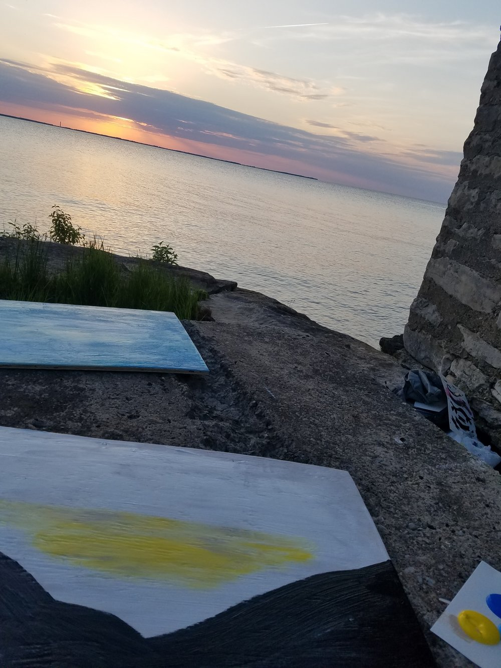 working on the two window paintings as the sun set over the lake. seriously.