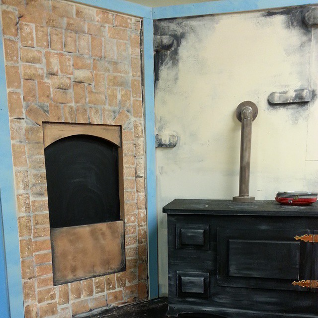 Painted scene for Mary Poppins - painted on bricks, soot, stove from a cabinet....
