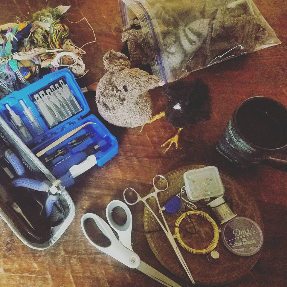 Set of pliers, wire cutters and knives    Hemostats  - I don't ever want to be without hemostats again! I have several sizes stashed away.    A thimble, thread, a multitude of needles (somehow lose them along the way!) wire and big plastic ziplock bags so I can take my projects on the go!    And COFFEE!