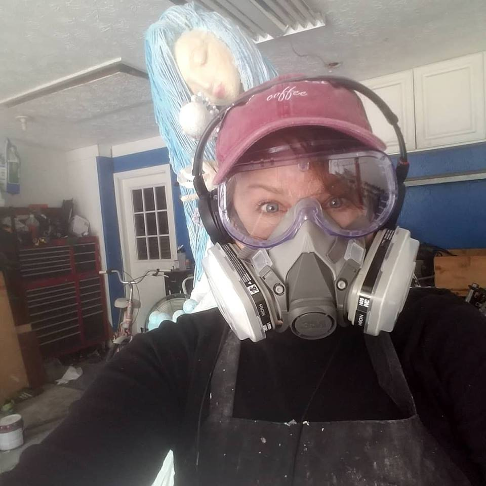Safety First!  This is the third Olay bubble girl and a lovely picture of my messy garage. I have a studio space, but 3 7 foot sculptures made of concrete would not fit up the stairs!  So I pushed everything aside, kicked my family out and got to work. I had  3 solid weeks  to complete these so it was my general look and state of mind for that time period!