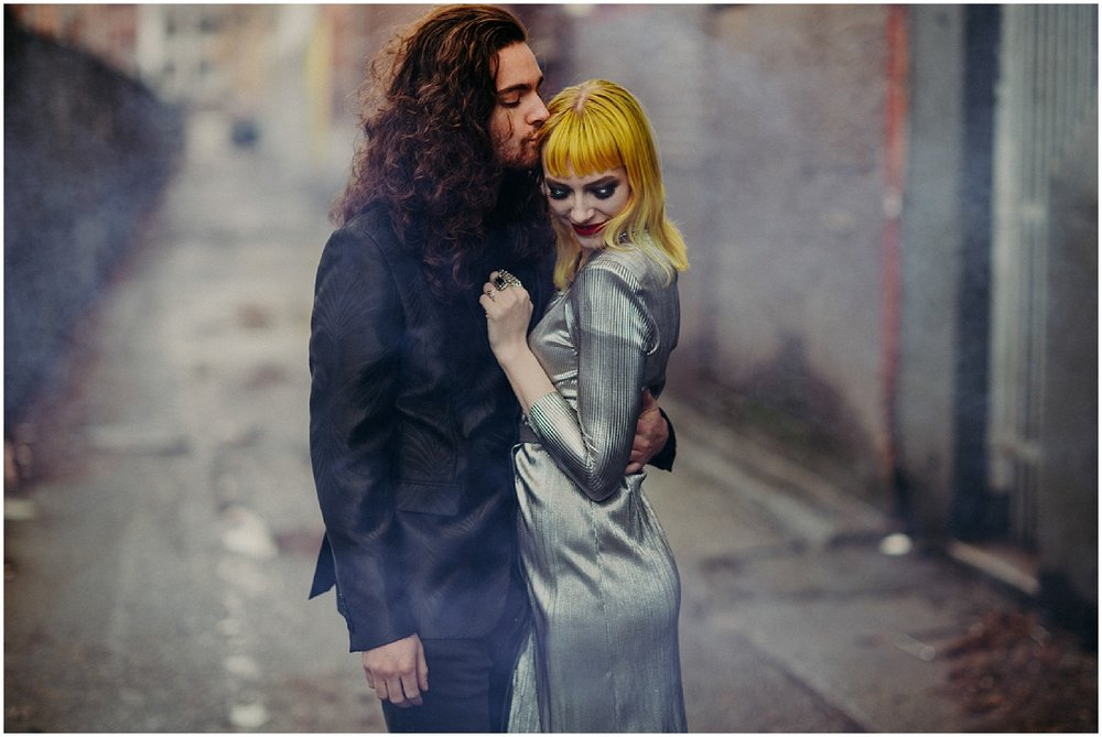 Vancouver love beautiful engagement couples session photography Urban steam Yellow hair blunt bangs centre part fingernails manicure curly long hair man glamour makeup red lips lipstick metallic dress retro modern black suit jacket