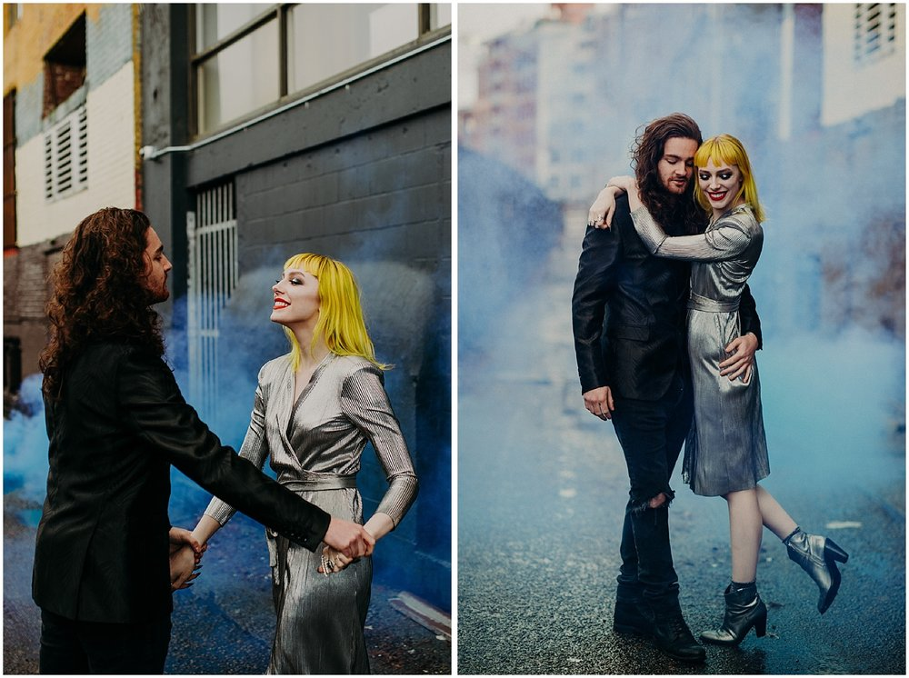 Vancouver back alley steam fog engagement couples session love fun smiles metallic dress black suit jacket red lips lipstick yellow hair concrete jungle retro modern blunt bangs
