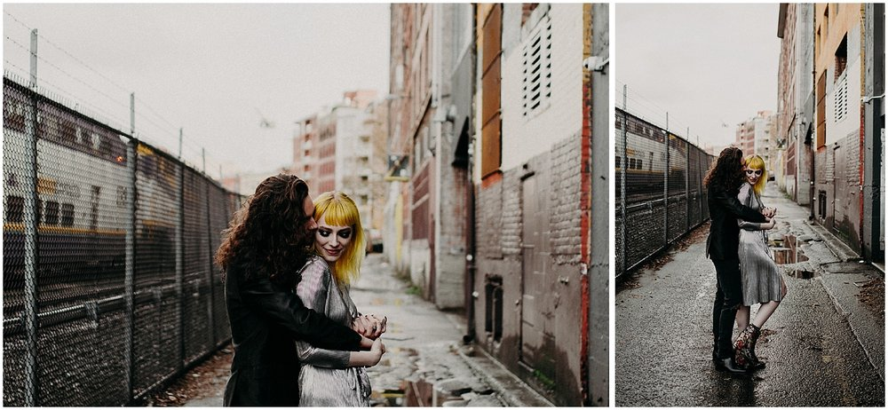 Vancouver back alley grunge session blood alley gas town tender love embrace chain link fence train couple engagement session