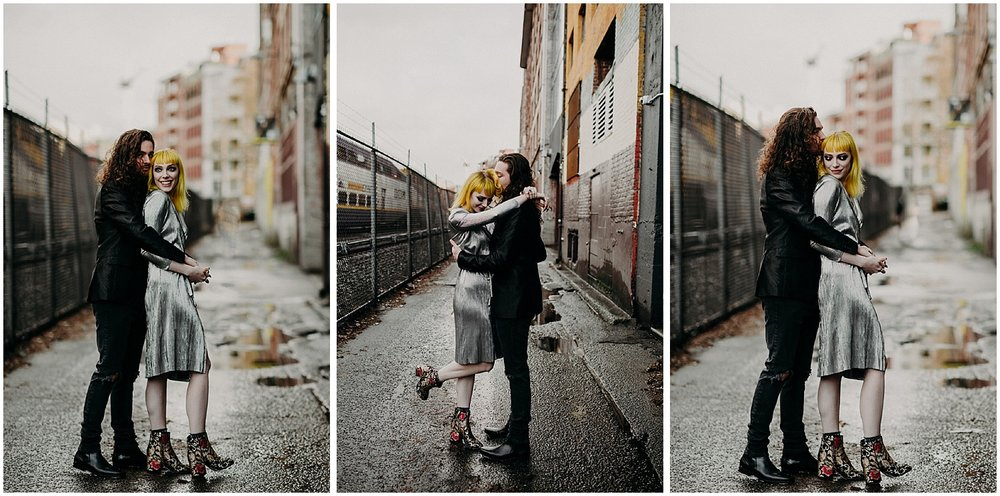 Vancouver engagement couples session fashion gastown back alley love metallic dress black suit rad women chain link fence train city unique shoes