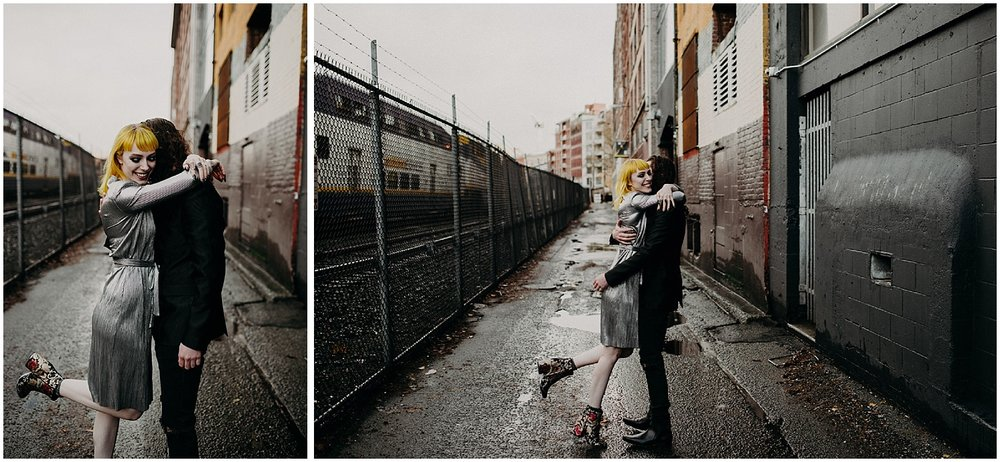 Vancouver back alley couples engagement session chain link fence yellow hair metallic dress love hug train yard