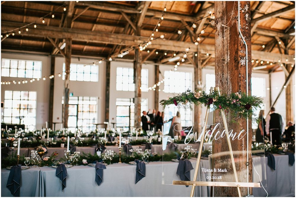 north vancouver diy wedding calligraphy glass sign greenery pipe shop venue decor wedding intimate elopement long table decor by stacie carr photography