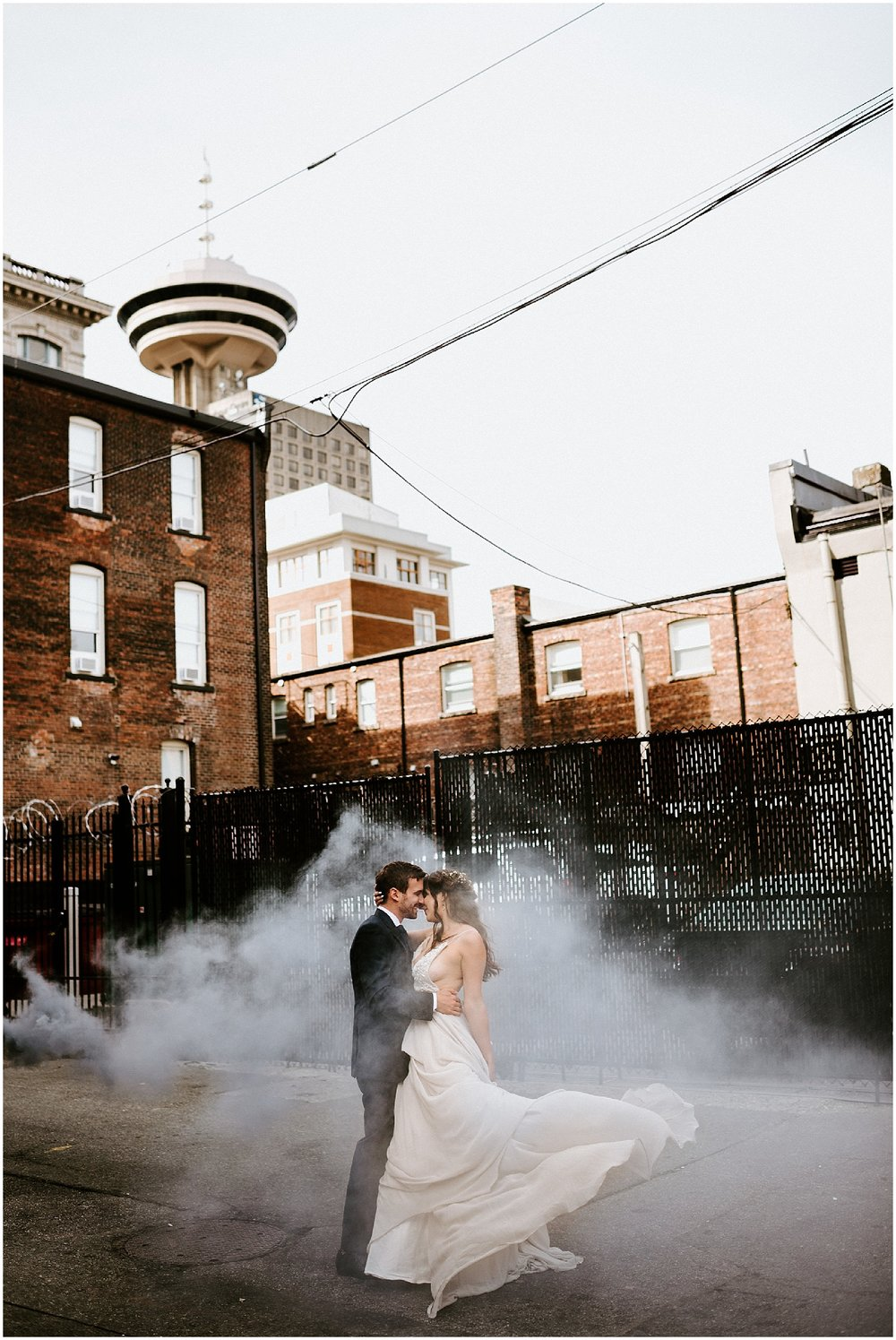 downtown vancouver urban wedding photo back alley couple manhole steam