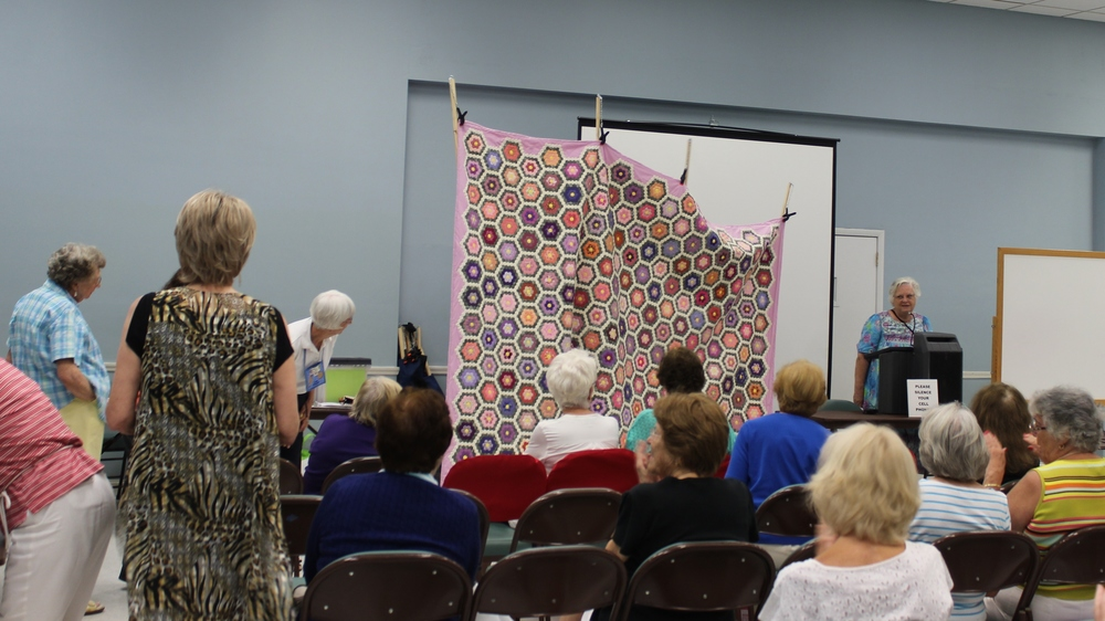 Pole method for displaying quilts.jpg
