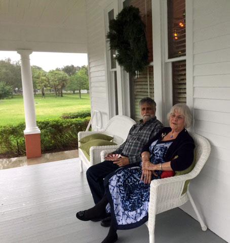 Jan Silverstein and husband   enjoying the wide veranda and garden.jpg