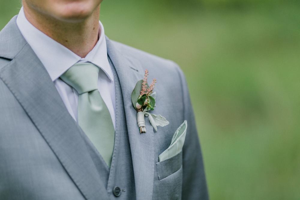 blush boutonniere - wedding florist in winnipeg