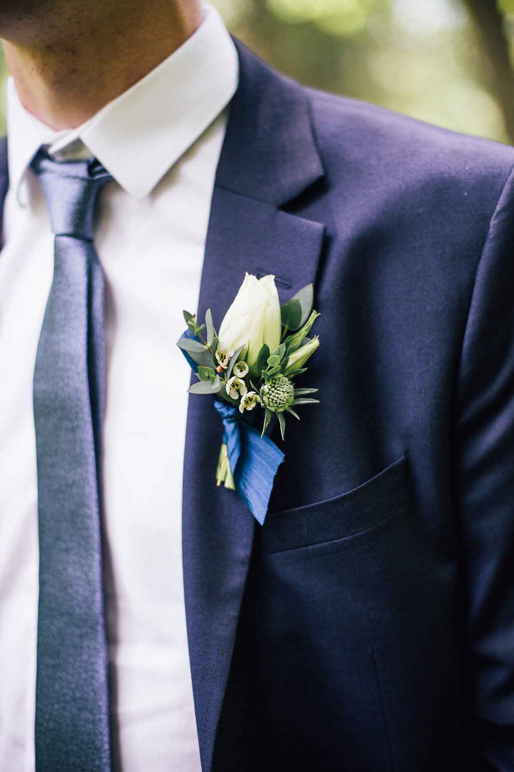 Textured white boutonniere - Wedding Florists Winnipeg