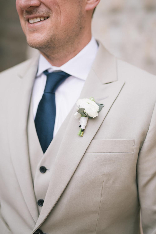 White ranunculus boutonniere - Wedding Florist in Winnipeg