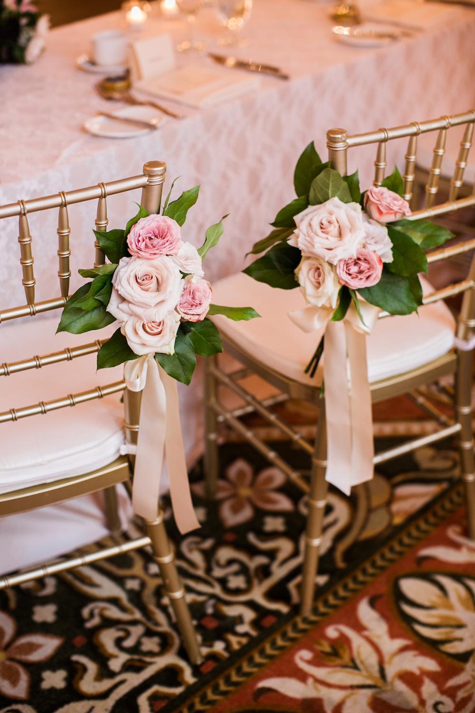 Bride and Groom Chair Flowers - Winnipeg Weddings