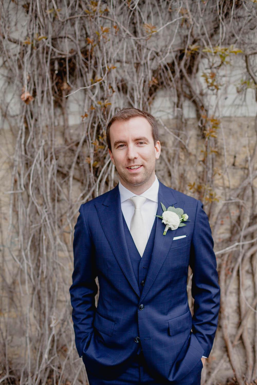white-ranunculus-boutonniere--spring-wedding-flowers.jpg