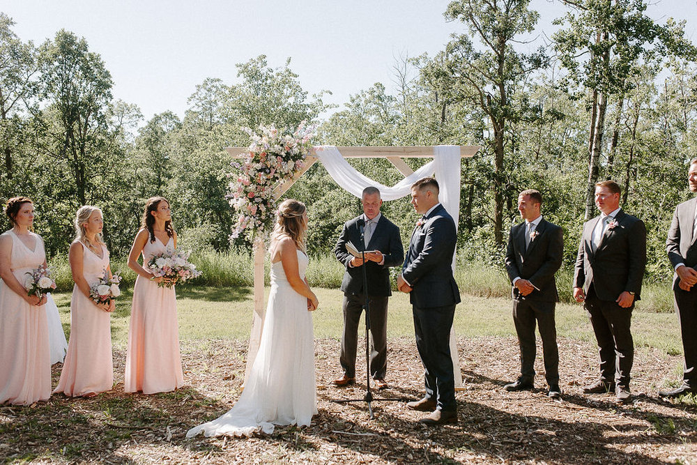 Outdoor Wedding Ceremony at Pine Ridge Hollow - Wedding flowers on Outdoor Arch