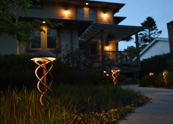 Landscape lighting transforms a property after dark.