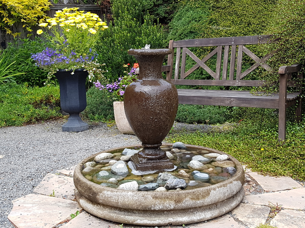 The combination of bench and urn fountain invites quiet contemplation.
