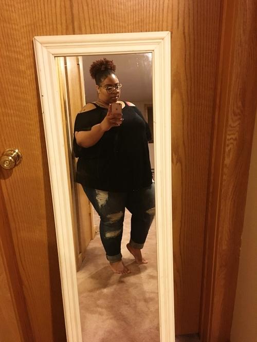 Wearing the cold shoulder black top