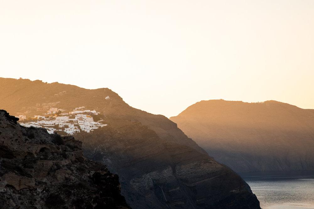 Santorini Cliffs Sunrise Rays-1.jpg