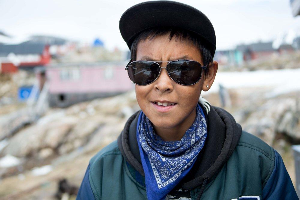 Robert, an adventurous fourteen-year-old from Kuummiut.