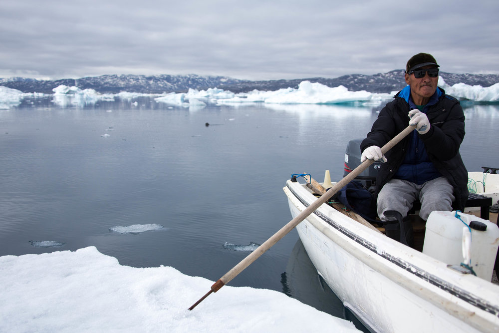 Stoping on an iceberg to collect fresh drinking water.