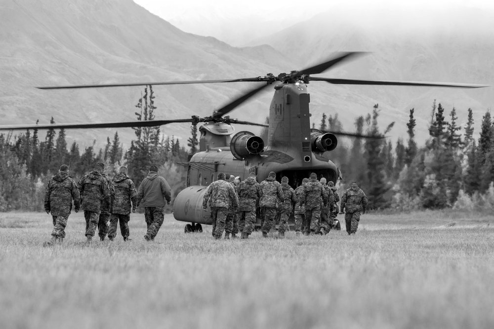 Soldiers board a Chinook Helicopter at our makeshift camp outside of Haines Junction, Yukon Territory. Chinook pilots are quite an elite group in the Canadian Air Force and many soldiers were eager for a change to ride in the Chinook. This group of soldiers and Rangers was going on a brief reconnoissance mission in the Kluane Mountains.