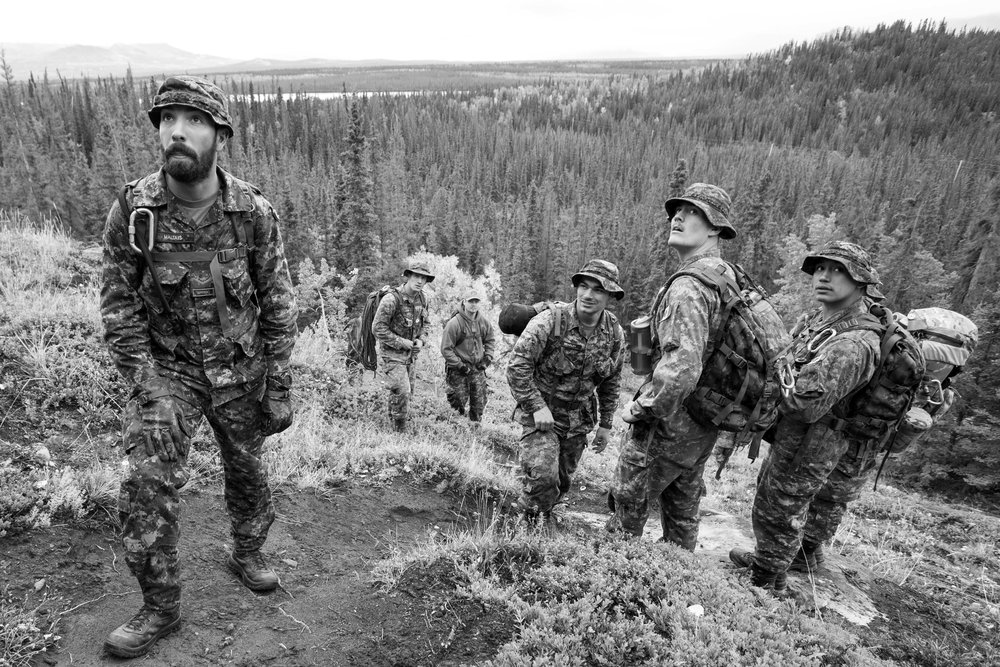 Soldiers from the 12e Régiment blindé du Canada from Valcartier, Quebec hike up Paint Mountain just outside Haines Junction, Yukon. Carrying full packs and medical supplies, this day hike helped build teamwork, as well as emergency response preparedness as emergency radio broadcasts were common throughout the day.