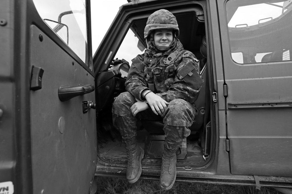 A friendly soldier from Montreal showed me around the militarized Mercedes G Class. I snapped this photo of her with my 17mm lens as she sat in the front seat with the door open. They were on stand-by during a natural disaster response drill outside Haines Junction, YT.