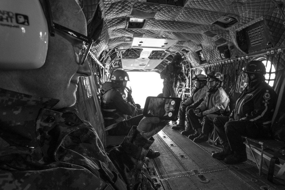 Capt Lynne Patterson FaceTimes with her husband and daughter from inside a Chinook Helicopter over the Kluane Mountains in western Yukon Territory. It was also Capt Patterson's first time in the Chinook and she was so excited that she wanted her family to experience this with her. Watching them was a moving experience for me too, as a photographer and filmmaker.
