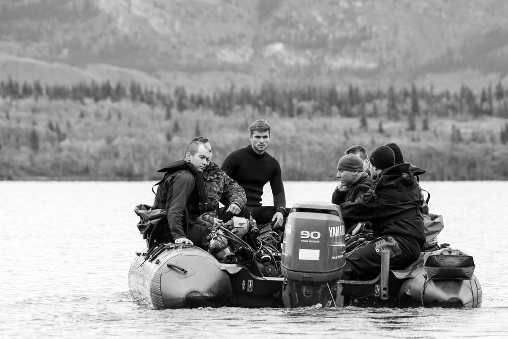 Divers from the Canadian Navy take a zodiac boat out to a dive site on Lake Laberge, just north of Whitehorse. The water was frigid, but of course nobody complained.