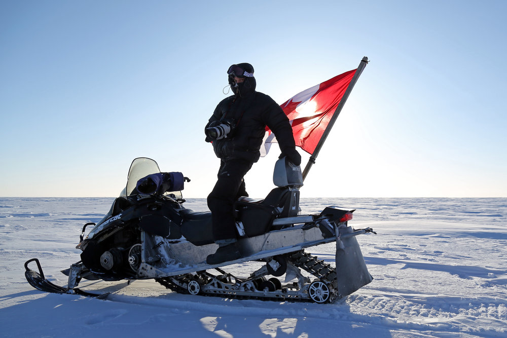 Me on the back of a Ranger's skidoo in Nunavut.