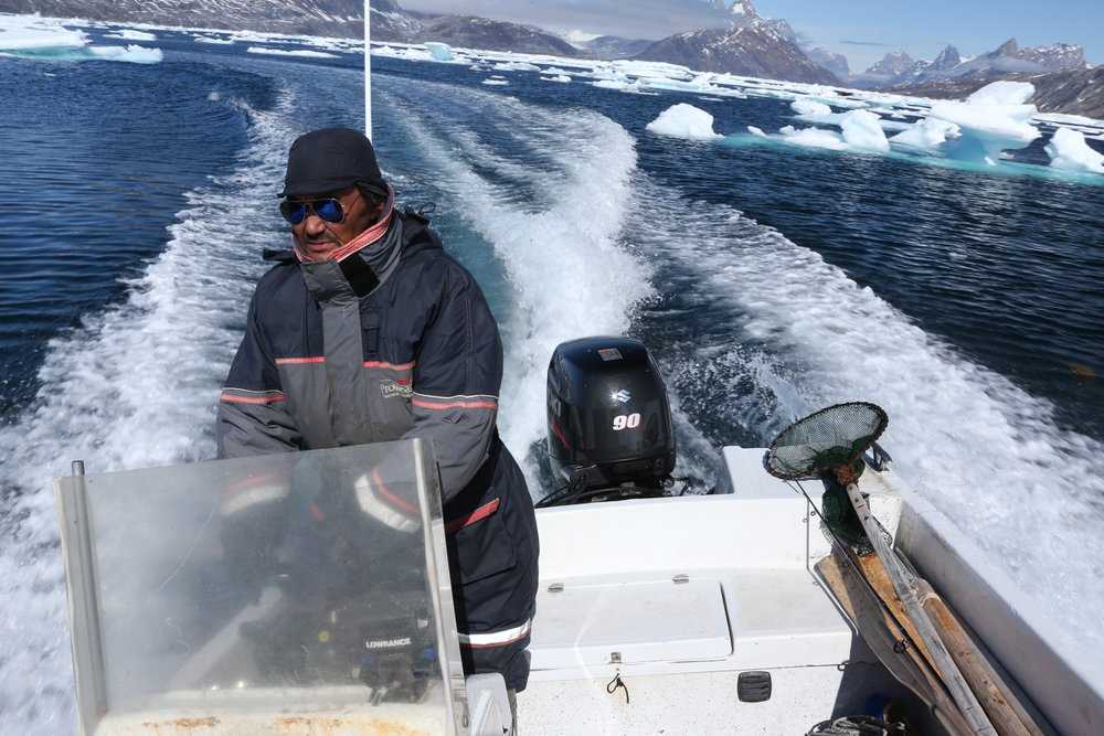 illi-driving-his-boat-in-east-greenland.jpg