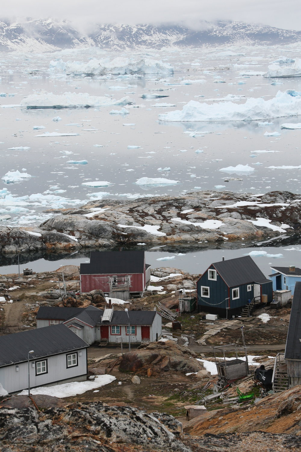 The settlement of Tinit, Greenland, with the ice fjord in the background.