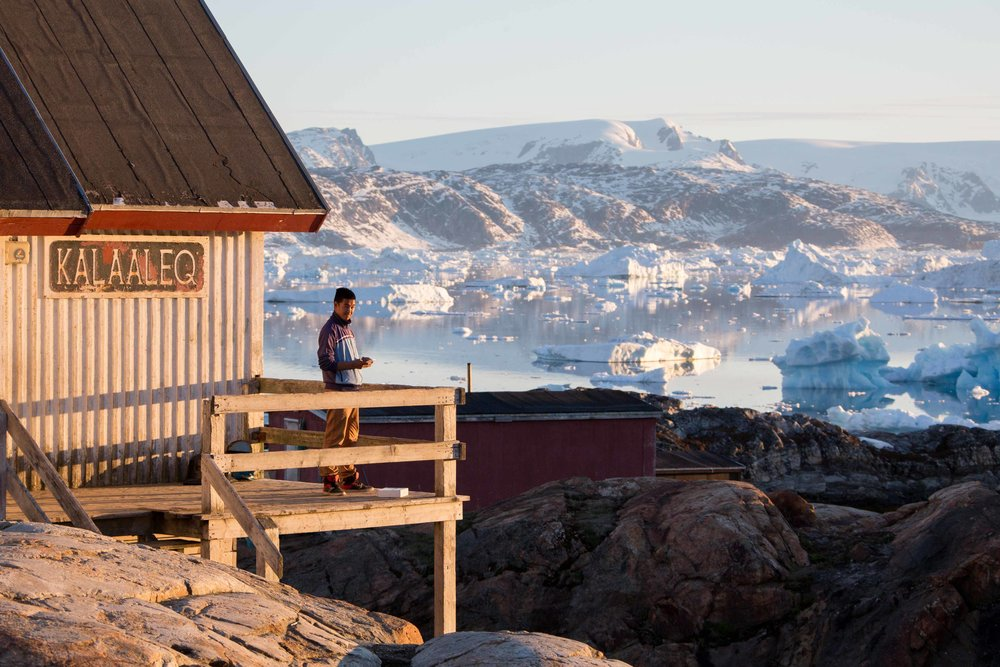 boy-standing-next-to-the-shop-in-tinit-greenland.jpg