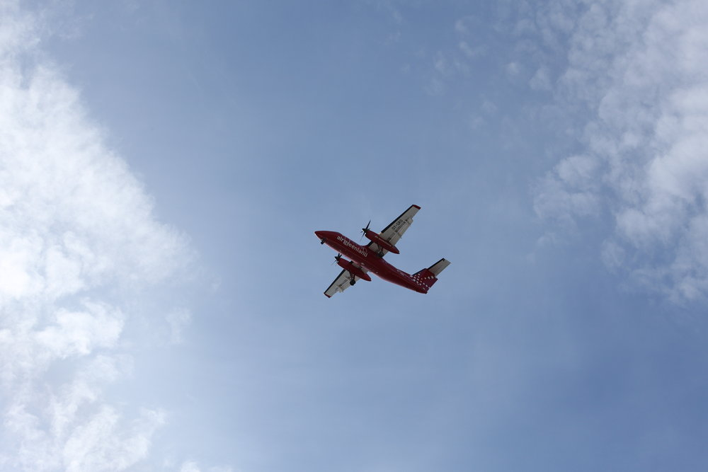 An Air Greenland Dash-8 Approaches Kulusuk Airport form Nuuk, Greenland.
