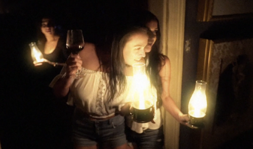 (Lantern in one hand and wine in the other. This woman is a professional!)