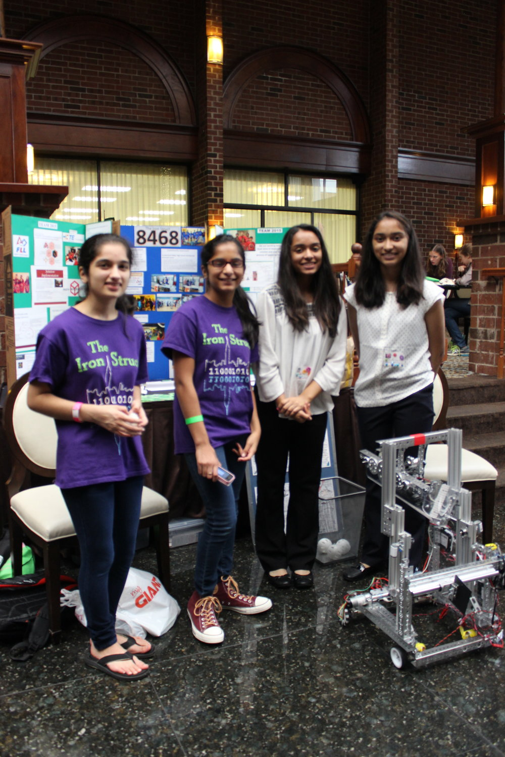Krittika, Susan, Sarah, Rachael, and the demo robot. Girls World Expo, October 2016.