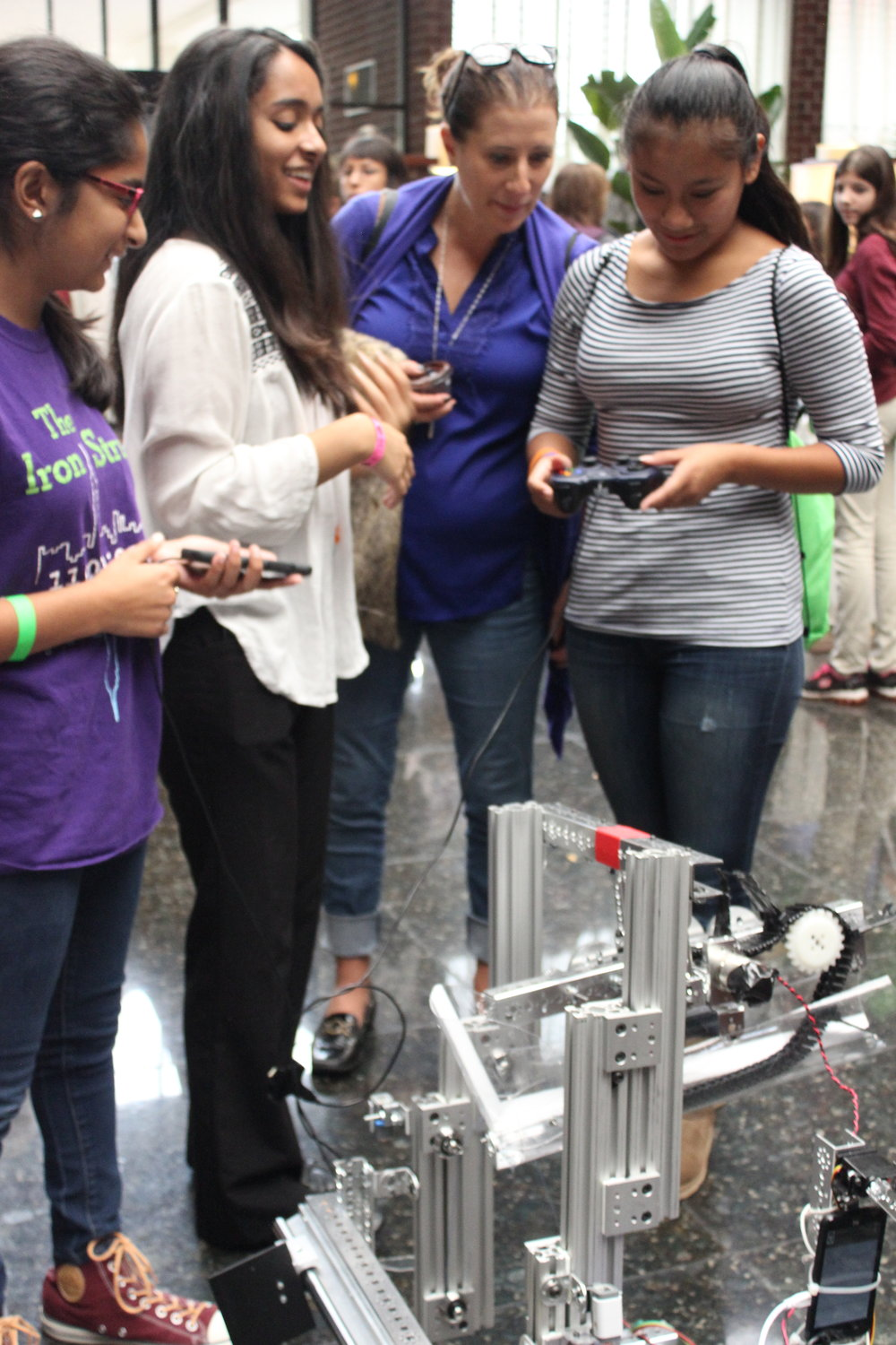 Sarah and Susan help girls drive the robot. Girls World Expo, October 2016.